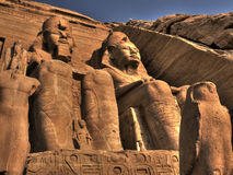 Statues at the entrance to the Abu Simbel Temple (Egypt) Stock Photos