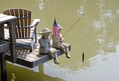 Statues on the Erie Canal. Stone figures holding a flag on the Erie Canal Stock Image