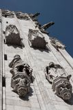 Statues on the facade of a church. White marble statues on the facade of a church Stock Photo