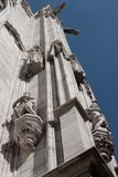 Statues on the facade of a church. White marble statues on the facade of a church Stock Photos