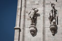 Statues on the facade of a church Stock Photos