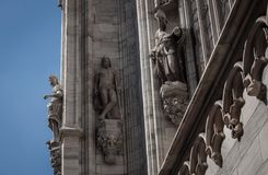 Statues on the facade of a church. White marble statues on the facade of a church Royalty Free Stock Image