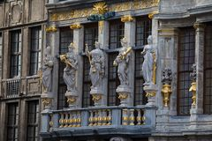 Statues on the facade of the house Le Renard. The Grand Place, the central square of Brussels, Belgium Royalty Free Stock Photos