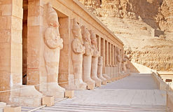 Statues on facade of palace of Hatshepsut in Luxor, Egypt Royalty Free Stock Image