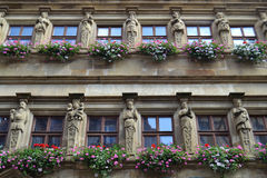 Statues and Flowers on a German Building Stock Photo