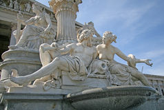Statues of the fountain in front of the Austrian Parliament in Vienna, Austria Stock Image