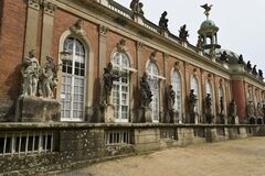 Statues framing arched windows Royalty Free Stock Photo