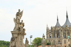 Statues in front of Cathedral of St. Barbara Stock Photography