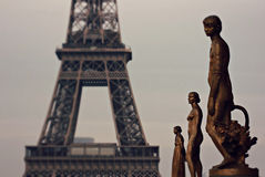 Statues in front of the Eiffel Tower Stock Images