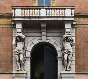 Statues in front of a house entry in Bologna, Italy.  Stock Photo