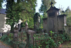 Statues and graves on old Olsany Cemeteries. PRAGUE, CZECH REPUBLIC - SEPTEMBER 29, 2016: Statues and graves on old Olsany Cemeteries - largest graveyard in Royalty Free Stock Photo