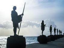 Statues of Guanches Kings at sunset Royalty Free Stock Photography