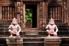 Statues guard Angkor  Wat temple Royalty Free Stock Photo