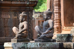 The Statues guard of Banteay Srei temple Stock Photo