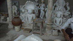 Statues of Hindu Gods and Goddess. Crafts and Arts of India. Mur. Ti handmade Manufacturing in Jaipur Rajasthan. Indian God sculpture made of white marble royalty free stock photo