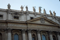 Statues on historic building. Stone statues on rooftop of historic building royalty free stock photography