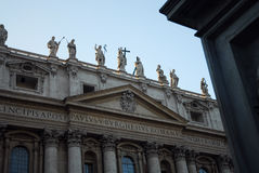 Statues on historic building. Statues on roof of historic stone building royalty free stock photo