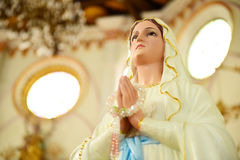 Statues of Holy Women in Roman Catholic Church Stock Images
