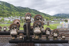 Statues of Japanese raccoon dog or tanuki at Torokko Kameoka Station Stock Images