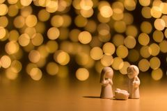 Statues of Joseph and Mary. In front of an illuminated dark wall Royalty Free Stock Image