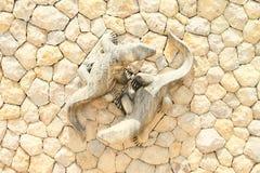 Statues of komodo dragons. On stone wall on entrance to Komodo National Park on Komodo Island, Nusa Tengara Timur - NTT, Indonesia Royalty Free Stock Photography