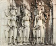 Statues of ladies carved on Angkor Wat Temple. Complex in Siem Reap, Cambodia. Ancient architecture, Unesco World Heritage Site stock images