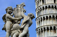 Statues and the Leaning Tower royalty free stock images