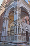Statues on loggia of the Torre del Mangia. (Siena, Italy) Royalty Free Stock Photos