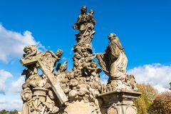 Statues of Madonna and Saint Bernard on Charles Bridge in Prague Stock Photos