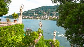 Statues on Maggiore lake background. Isola Bella garden view, summer. Statues on Maggiore lake background. Legacy of baroque art stock footage