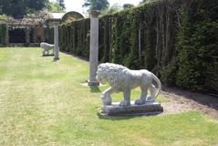 Statues of medici lions and columns at the Italian garden of Hever castle in England Stock Image