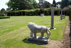 Statues of medici lions and columns at the Italian garden of Hever castle in England Royalty Free Stock Image