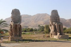 Statues of Memnon. Day view Statues of Memnon at Luxor, Egypt royalty free stock images