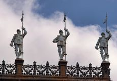 Statues of men guarding Paris. Statues of men guarding the Paris city in France Royalty Free Stock Images
