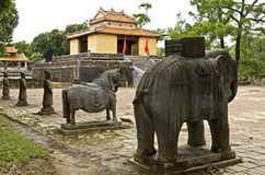 Statues at Minh Mang Tombs. Ancient statues carved from stone stand in front of the entrance to Minh Mang Tomb near Hue in Vietnam Stock Photo