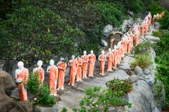 Statues of monks in Golden cave temple in Dambulla, Sri Lanka. Statues of monks on a rock in Golden cave temple in Dambulla, Sri Lanka Stock Photography