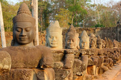 Statues Of Devas On Bridge To Angkor Thom Royalty Free Stock Images