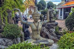 Statues Of Hermit At Showing A Posture Of Massage Therapy At Temple Of Reclining Buddha Or Wat Pho, Bangkok, Thailand Royalty Free Stock Photography