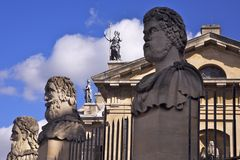 Statues in Oxford. Stone carved statues guard a university in the fmous city of Oxford in England royalty free stock photography