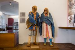 Statues of peasants at museum of Bled Castle royalty free stock image