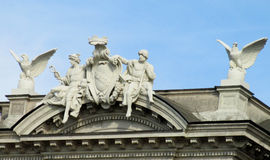 Statues of people and birds on a roof Royalty Free Stock Photo