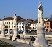 Statues and people on Prato della Valle, one of the largest square in Europe royalty free stock image