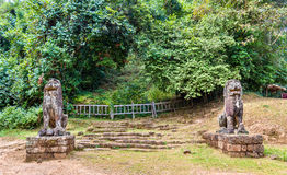 Statues at Phnom Bakheng in Angkor Wat - Cambodia Stock Image