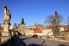 Statues on the Prague Charles Bridge with Castle Stock Photo