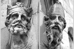 Statues principales découpées Photos stock
