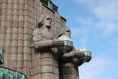 Statues at the railway station in Helsinki. Stock Photos