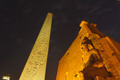 Statues of Ramses II at Luxor Temple. Luxor, Egypt. Statues of Ramses II at Luxor Temple at night. Luxor, Egypt stock image