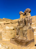 Statues of Ramses III. and Thoth at the mortuary temple Stock Photos