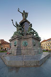 Statues from reconciliation Park of Arad, Romania. ARAD, ROMANIA - AUGUST 26, 2016: Statues and buildings from reconciliation Park of Arad, Romania Royalty Free Stock Photos