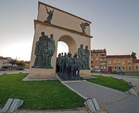 Statues from reconciliation Park of Arad, Romania. ARAD, ROMANIA - AUGUST 26, 2016: Statues and buildings from reconciliation Park of Arad, Romania Stock Images